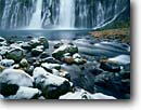 Stock photo. Caption: Burney Falls,  Hat Creek McArthur Burney Falls State Park Shasta  County Cascade Range,  California  --  waterfall waterfalls winter ice frozen freezing parks creek creeks united states america ranges cold icey icy tourist travel destination destinations attraction attractions springs frigid