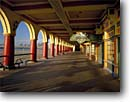 Stock photo. Caption: The Casino Santa Cruz Boardwalk  and Cowell Beach Santa Cruz, California -- county amusement park parks tourist destination destinations arch arches walkway walkways winter united states america boardwalks