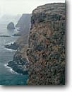Stock photo. Caption: Igneous rock cliffs East Anacapa Island Channel Islands National Park California -- parks pacific ocean coast coasts seascape seascapes united states america tourist destination destinations dramatic maritime coastline coastlines isolated isolation secluded solitude rugged shoreline shorelines reserve marine cliff