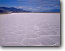 Stock photo. Caption: Salt flat patterns Death Valley Death Valley National Park Mojave Desert, California -- united states america deserts sand dune sands drought wind blown untracked trackless mohave pattern areas background backgrounds remote sunny clear flats cracks crack cracked caked arid parks hostile landscape landscapes scenics harsh arid