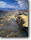Stock photo. Caption: Manly Beacon and  Death Valley   from Golden Canyon Death Valley National Park Mojave Desert, California -- united states america deserts sunny clear arid parks hostile landscape landscapes scenics harsh arid canyons hikes hiking area erosion eroded landmark landmarks rugged geology geologic formations formation