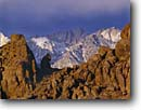 Stock photo. Caption: Alabama Hills   and Mt. Whitney Eastern Sierra Nevada Inyo County,  California -- Keywords: united states america landscape landscapes clear scenic scenics scene canyons distance view views vista vistas mountains deserts snow covered sierras mountain contrast destination destinations movie movies iconic icons highest landmark landmarks granite