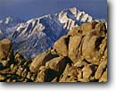 Stock photo. Caption: Granite  outcrops in Alabama Hills   and Lone Pine Peak Eastern Sierra Nevada Inyo County,  California -- Keywords: united states america landscape landscapes clear scenic scenics scene canyons distance view views vista vistas mountains deserts snow covered sierras mountain contrast destination destinations movie movies iconic icons highest landmark landmarks