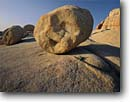 Stock photo. Caption: Granite boulders in Jumbo Rocks Joshua Tree National Park Mojave Desert Riverside County,  California -- granite rock  sunrises parks deserts mohave united states america solitude landscapes landscape travel tourist destination destinations arid dry weathered eroded erosion smiley face round smile humor humorous round scenics scenic