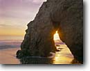 Stock photo. Caption: Sea arch El Matador State Beach Los Angeles County California -- beaches parks seastacks arches pacific ocean coast sunset sunsets dusk waves united states america seastack west coasts seascape seascapes travel tourist destination destinations Robert Meyer Memorial Beaches sunburst sunbursts winter southern sunbeams