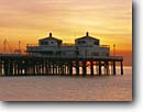 Stock photo. Caption: Malibu Pier Malibu Surfrider State Beach Los Angeles County California -- beaches pacific ocean coast sunset sunsets waves united states america west coasts seascape seascapes  tourist destination destinations historic historical building buildings seascape seascapes pacific coast beach beaches pilings fishing piers southern
