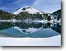 Stock photo. Caption: Lassen Peak from Lake Helen Lassen Volcanic National Park Cascade Range California -- volcano volcanoes lakes reflection reflections tranquil parks peaks cone cones mountains summer united states america ranges landscape landscapes tourist destination destinations cascades independence majestic courage snow snowmelt achievement clear