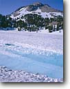 Stock photo. Caption: Lassen Peak   from Lake Helen Lassen Volcanic National Park Cascade Range,  California -- united states america high mountain high country highcountry winter spring snow covered snowy mount volcanic   snowy mountains landscape landscapes thaw thawing frozen lakes parks cascades icey peaks