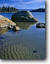 Stock photo. Caption: Glacier erratics in Emerald Bay Emerald Bay State Park Lake Tahoe Sierra Nevada,  California -- lakes united states america summer peaks tranquil calm landscape landscapes placid mountains pristine range ranges serene clear clarity travel tourist destination destinations sierras parks ripples sandy beach rippled pure clean granite erratic