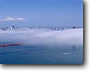 Stock photo. Caption: Summer fog and Golden Gate Bridge   and San Francisco Bay Golden Gate National Recreation Area Marin County,  California -- city cityscapes cityscape areas urban  united states travel tourist destination destinations landmark landmarks recreation bridges suspension skyline skylines icon icons attraction attractions highway highways symbols symbol bays foggy