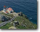 Stock photo. Caption: Point Reyes Lighthouse Point Reyes National Seashore Marin County California -- landscape landscapes coasts west pacific coastline coastlines summer seashores seascape seascapes ocean oceans sunny clear scenics scenic rugged lighthouses station light house building buildings landmarks landmark steps isolated destination destinations
