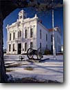 Stock photo. Caption: County Courthouse Bridgeport Mono County California -- united states america eastern sierra nevada sierras town pioneer gold rush mining towns stone building buildings courthouses center cannon snow winter imposing blue skies clear crisp government flagpole white