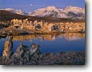 Stock photo. Caption: Tufa formations and Sierra Nevada South Mono Lake Tufa Area Mono Lake State Reserve Mono Basin National Scenic Area Great Basin, California -- landscape landscapes scenic scenics summer blue skies clear sunny moon moons moonrise eastern reflection reflections lakes calm landmarks landmark