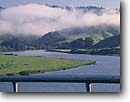 Stock photo. Caption: Highway 101 over Russian River   near Jenner Sonoma Coast State Beach Sonoma County,  California -- united states america rural travel tourist destination destinations spring bridge bridges foggy rivers clear sunny blue skies spring scenics estuary estuaries wetlands wetland habitat habitats landscape landscapes rolling hills scenic scenics  road roads