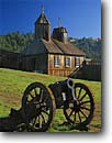 Stock photo. Caption: Russian cannon & Chapel Fort Ross State Historic Park Sonoma County California -- united states america cannons church chapels churches parks historical forts protection defense colonization pacific coast spring blue skies sunny history wooden building buildings west coast northern coastal crosses cross exhibit exhibits scenics scenic