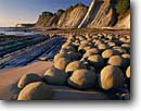 Stock photo. Caption: Sandstone concretions Bowling Ball Beach,  Schooner Gulch Mendocino State Parks Unit Mendocino County,  California -- seascape seascapes pacific ocean tide minus north coast tidepool tidepools erosion eroded headlands geology geologic eroded tides dramatic inspirational round patterns pattern design designs west coastal unusual striking features natural clear sunny lanes