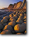 Stock photo. Caption: Sandstone concretions Bowling Ball Beach Mendocino State Parks Mendocino County, California -- seascape seascapes pacific ocean tide minus north coast tidepool tidepools erosion eroded headlands geology geologic eroded tides dramatic inspirational Schooner Gulch round patterns pattern design designs west coastal unusual striking features natural