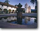 Stock photo. Caption: Mission Santa Barbara   at sunrise Santa Barbara Santa Barbara County,  California -- missions church churches religion religious morning light buildings america worship missionary period spanish catholic christian christianity fountain fountains plaza plazas historical history pueblo pueblos southern tourist attractions landmarks landmark