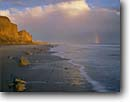 Stock photo. Caption: San Augustine Beach Hollister Ranch Santa Barbara County,  California -- united states america seascape seascapes stormy clouds pacific ocean channel reflections reflection beaches sandy surf winter wintery dramatic west rainbow rainbows coastline coastlines southern secluded exclusive private seashore seashores coastal scenic