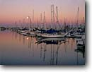 Stock photo. Caption: Moonset Ventura Harbor Ventura County California -- moon moons harbors harbours sailboat sailboats dawn pleasure craft safe united states america pacific coast west southern reflection reflections masts lined calm tranquil tranquility boats boat boating interlude quiet anticipation leisure opulence luxury
