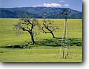 Stock photo. Caption: Windmill and Santa Ynez Mountains Santa Ynez Valley Santa Barbara County California -- south coast ranges landscapes landscape farming farm rural agriculture pastoral bountiful foothills windmills spring flowers grassland grasslands ranch ranching ranchland southern americana ranch ranching ranches power sunny energy alternative green