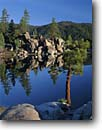 Stock photo. Caption: Boulder Bay Big Bear Lake San Bernardino Mountains California -- county mountains lakes tranquil resort area tree pines granite boulders morning spring national forest forests ponderosa pine tourist destination destinations southern transverse range ranges landscape landscapes reflections reflection blue sunny calm