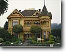 Stock photo. Caption: The Gingerbread Mansion Ferndale Humboldt County California -- americana nostalgic nostalgia united states america cloudy historic historical building buildings victorian victorians famous house houses classy classic