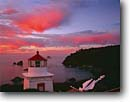 Stock photo. Caption: Memorial Lighthouse Trinidad Bay and Trinidad Head Trinidad Humboldt County, California -- seascape seascapes inspirational winter sunrise christmas clouds lighthouses pacific coast ocean fishing village villages coastal town towns protection beacon beacons direction guidance lights navigation america sunrises anchor anchors decorated