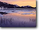 Stock photo. Caption: Spring thaw at sunset Tenaya Lake Yosemite National Park Sierra Nevada,  California -- united states america sunsets mountain mountains peaks placid world heritage site sites parks landscape landscapes tourist destination destinations cold ice snow melting winter scenic lakes spring thawing melt pristine high country sierras