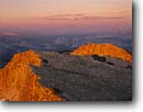 Stock photo. Caption: Summit Mount Hoffman at sunset Tuolumne Meadows in the distance Yosemite National Park Sierra Nevada,  California -- united states america domes granite summer sunsets mountains peaks placid sunsets world heritage site sites domes parks landscape landscapes tourist destination destinations alpenglow dramatic warmth glacial glacier glaciated high country sierras