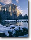 Stock photo. Caption: Merced River and El Capitan  Yosemite Valley Yosemite National Park Sierra Nevada,  California -- granite domes parks mountains parks dramatic light inspiration inspire spectacular vacation destination rock face rockface alpine glow united states america world heritage site sites landscapes alpenglow snow winter snowfall sierras landscape scenic sunny
