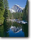 Stock photo. Caption: Merced River and Half Dome Yosemite Valley Yosemite National Park Sierra Nevada,  California -- winter snow cold parks tourist holiday attraction attractions united states america destination destinations travel feature features natural sierras family vacation granite domes rivers valleys mountain mountains landscape landscapes