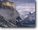 Stock photo. Caption: El Capitan,  Half Dome  and Yosemite Valley from Tunnel View Yosemite National Park Sierra Nevada,  California -- united states america parks world heritage site sites sierras tourist travel destination destinations family vacation attraction attractions snow snowy winter winyery vista views domes landscape landscapes clearing storm storms glacially carved valleys