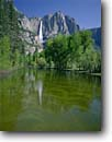 Stock photo. Caption: Yosemite Falls reflects in Merced River Yosemite Valley Yosemite National Park Sierra Nevada, California -- granite domes glaciated glacial parks world heritage site sites landscape landscapes pristine tourist attraction attractions clear vacation destination destinations sierras icon icons famous nature natural rivers waterfall waterfalls reflections blue