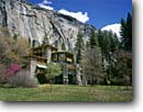 Stock photo. Caption: Ahwahnee Hotel and Royal Arch Cascade Yosemite Valley Yosemite National Park Sierra Nevada, California -- landscape landscapes west scenics scenic spring parks sierras destination destinations attraction attractions landmarks landmark quiet valleys place domes waterfall waterfalls hotels lodging building buildings luxury lodge clear sunny blue skies flowering