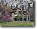 Stock photo. Caption: Ahwahnee Hotel and Royal Arch Cascade Yosemite Valley Yosemite National Park Sierra Nevada, California -- landscape landscapes west scenics scenic spring parks sierras attraction attractions landmarks landmark quiet valleys place domes waterfall waterfalls hotels lodging building buildings luxury lodge flowering stone local stones world heritage site sites
