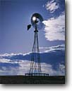 Stock photo. Caption: Windmill and water tank Pawnee National Grassland Great Plains Colorado -- Keywords: windmills cattle tanks grasslands united states america summer spinning twirling spinning spin prairie prairies pumping windy rural wind windy energy generator generators