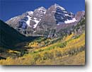 Stock photo. Caption: Aspens and Maroon Bells Maroon Creek Canyon, Elk Mountains White River National Forest Rocky Mountains, Colorado -- aspen fall peak peaks autumn rockies  snow capped landscape landscapes dramatic majestic mountain color colors forests fourteener fourteeners highcountry arete geology geologic spectacular breathtaking destination sunny blue skies clear dramatic soaring