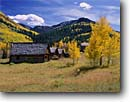 Stock photo. Caption: Ghost town of Ashcroft Castle Creek Canyon, Elk Mountains White River National Forest Rocky Mountains,  Colorado -- united states america towns historic historical mining gold rushes rockies mountain  building buildings aspen aspens fall autumn color colors yesteryear dilapidated sunny mines wooden history scenic landscapes landscape scenics blue