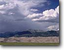 Stock photo. Caption: Great Sand Dunes and Sangre de Cristo Range Great Sand Dunes National Park  Rocky Mountains, Colorado -- united states america monsoons monsoon season storm stormy parks dune clouds dramatic light summer peaks mountains thunderstorm thunderstorms dark skies breathtaking primal ethereal weather unusual patterns majestic drama landscapes landscape scenic views