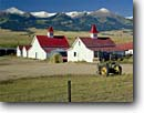 Stock photo. Caption: Ranch on Highway 69   near Westcliffe Sangre de Cristo Mountain Range Rocky Mountains, Colorado -- landscape landscapes scenic scenics scene country rockies peaks summer travel tourist ranching ranches peak ranges sunny clear skies blue tractor tractor farm implements building buildings vintage john deere antique antiques