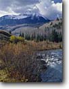 Stock photo. Caption: Sunshine Mountain South Fork San Miguel River San Juan Mountains Rocky Mountains,  Colorado -- united states america valley parks southern rockies creeks aspens spruces water flowing fresh clean clear  free freedom rivers skiing area hills fall autumn snowfall snow landscape landscapes creeks creek cloudy clouds stormy scenic scenics