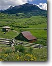 Stock photo. Caption: Old homestead on Hastings Mesa North Pole Peak San Juan Mountains Rocky Mountains,  Colorado -- barns homesteads wooden vintage  country trees rural blue skies nostalgia nostalgic buildings quaint americana town rural state rustic barn ranch historic historical ranches ranching rural nostalgia building heritage family outhouse scenic scenics summer