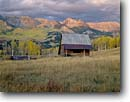 Stock photo. Caption: Old homestead   near Telluride San Juan Mountains Rocky Mountains, Colorado -- landscape landscapes scenic scenics scene barns building buildings sunny clear blue skies fall autumn wooden grasses pastoral rural heritage historic history settlers agriculture roads fence homesteads mesas color colors colour colours mountain rockies