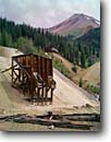 Stock photo. Caption: Idarado Mine and Red Mountain Uncompahgre National Forest San Juan Mountains Rocky Mountains, Colorado -- united states historic historical mines gold rushes rush building buildings americana summer mineral extraction landscape landscapes scenic scenics stamp mill mills legacy tourist attraction ghost destruction tailings barren result
