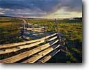 Stock photo. Caption: Aspen log fence Dallas Divide San Juan Mountains Rocky Mountains,  Colorado -- pole fences fence aspens trees forest rural summer countryside country rocky mountain cattle ranch ranches rural rustic ranching fenceline fencelines winding grazing land pasureland fenced western west dramatic skies scenics landscapes landscape scenic