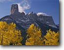 Stock photo. Caption: Aspens, Chimney Rock  and Courthouse Mountain Owl Creek Pass Uncompahgre National Forest San Juan Mountains Rocky Mountains, Colorado -- Rockies aspen fall peak peaks united states america landscape landscapes dramatic majestic mountain forests tree trees spruce spruces arete spire spires tower towering eroded erosion colours colour snow snowfall color blue skies sunny clear fresh snow