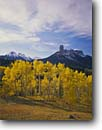 Stock photo. Caption: Aspens, Chimney Rock, Dunsinane and Precipice Peak, Owl Creek Pass Uncompahgre National Forest San Juan Mountains, Colorado -- Rocky Mountains Rockies aspen fall  peaks united states america landscape landscapes dramatic majestic mountain forests tree trees arete spire spires tower towering eroded erosion colours colour snow snowfall color fresh clouds scenic scenics quiet