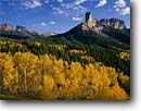 Stock photo. Caption: Aspens, Chimney Rock, Dunsinane    and Precipice Peak Owl Creek Pass Uncompahgre National Forest San Juan Mountains, Colorado -- Rocky aspen fall peak peaks autumn rockies united states america landscape landscapes dramatic majestic mountain color colors forests tree trees deciduous spruce spruces arete grand sweeping view sunny clear blue skies scenics scenic snow foliage