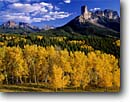 Stock photo. Caption: Aspens, Chimney Rock, Dunsinane and   Precipice Peak, Owl Creek Pass Uncompahgre National Forest San Juan Mountains, Colorado -- Rocky aspen fall peak peaks autumn rockies united states america landscape landscapes dramatic majestic mountain color colors forests tree trees deciduous spruce spruces arete sweeping view views vista scenic  sunny clear blue skies scenics scenic snow